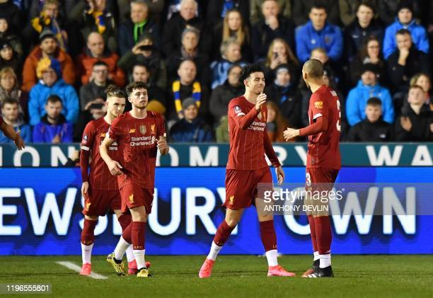 Liverpool's English midfielder Curtis Jones celebrates scoring the opening goal during the English FA Cup fourth round football match between between...