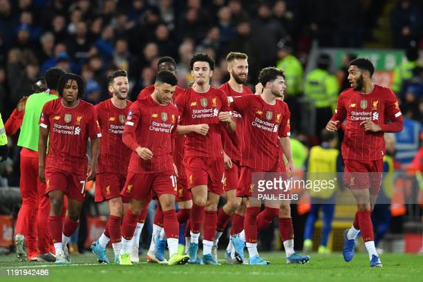 Liverpool's English midfielder Curtis Jones celebrates with teammates after scoring the opening goal of the English FA Cup third round football match...