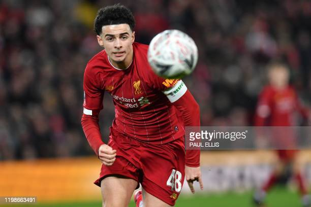 Liverpool's English midfielder Curtis Jones chases the ball during the English FA Cup fourth round reply football match between Liverpool and...