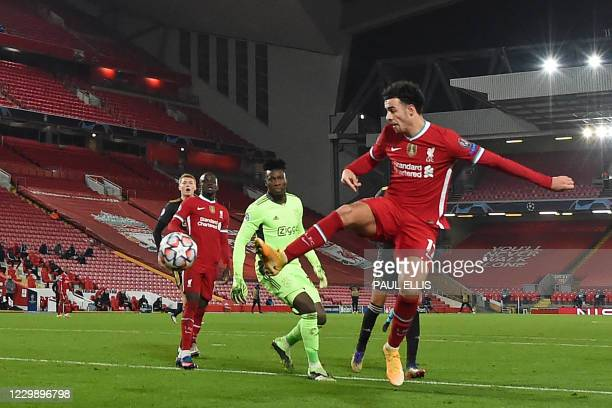 Liverpool's English midfielder Curtis Jones scores the opening goal during the UEFA Champions League 1st round Group D football match between...