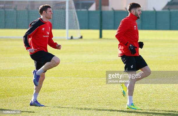 Liverpool's English midfielder James Milner and Liverpool's English midfielder Adam Lallana in action during team training session at the Melwood...