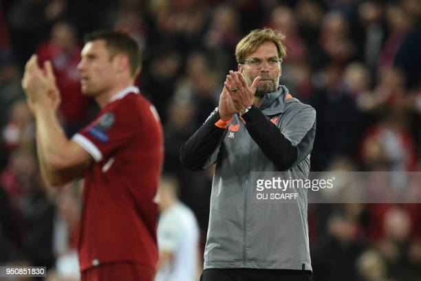 Liverpool's English midfielder James Milner and Liverpool's German manager Jurgen Klopp applaud fans after winning the UEFA Champions League first...