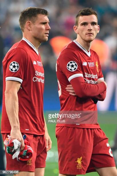 Liverpool's English midfielder James Milner and Liverpool's Scottish defender Andrew Robertson react on the pitch after defeat in the UEFA Champions...
