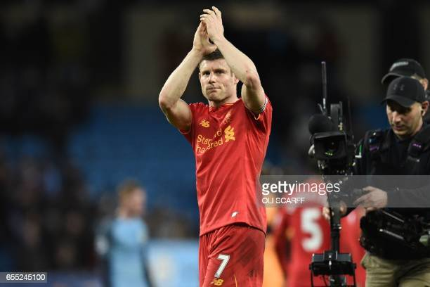 Liverpool's English midfielder James Milner applauds supporters on the pitch after the English Premier League football match between Manchester City...