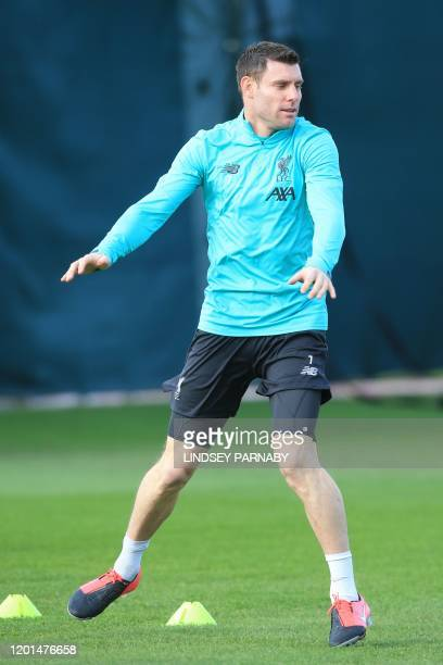 Liverpool's English midfielder James Milner attends a training session at Melwood in Liverpool north west England on February 17 on the eve of their...