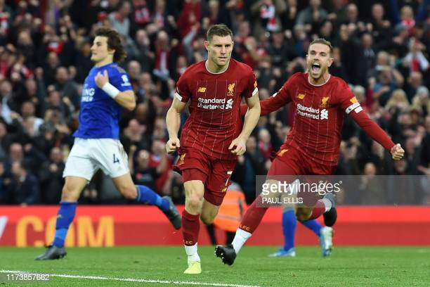 Liverpool's English midfielder James Milner celebrates after he kicks a penalty and scores his team's second goal during the English Premier League...