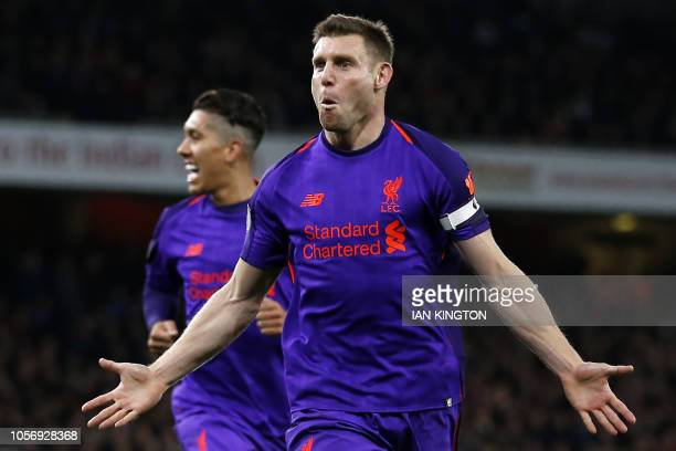 Liverpool's English midfielder James Milner celebrates after scoring the opening goal of the English Premier League football match between Arsenal...