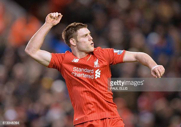 Liverpool's English midfielder James Milner celebrates after scoring their second goal during the English Premier League football match between...