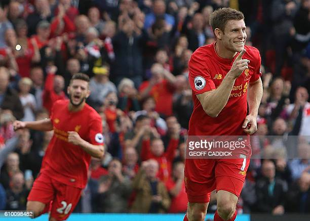 Liverpool's English midfielder James Milner celebrates after shooting from the penalty spot to score his team's second goal during the English...