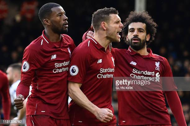 Liverpool's English midfielder James Milner celebrates scoring the team's second goal during the English Premier League football match between Fulham...