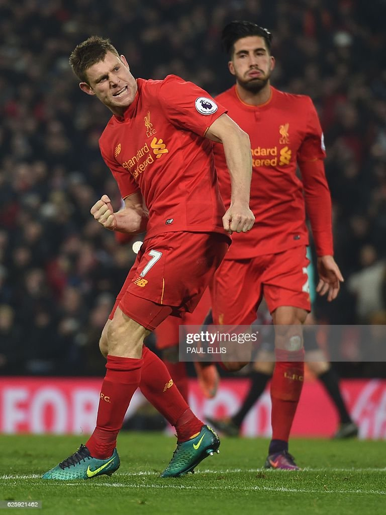Liverpool's English midfielder James Milner celebrates scoring their second goal during the English Premier League football match between Liverpool and Sunderland at Anfield in Liverpool, north west England on November 26, 2016. / AFP / Paul ELLIS / RESTRICTED TO EDITORIAL USE. No use with unauthorized audio, video, data, fixture lists, club/league logos or 'live' services. Online in-match use limited to 75 images, no video emulation. No use in betting, games or single club/league/player publications. /