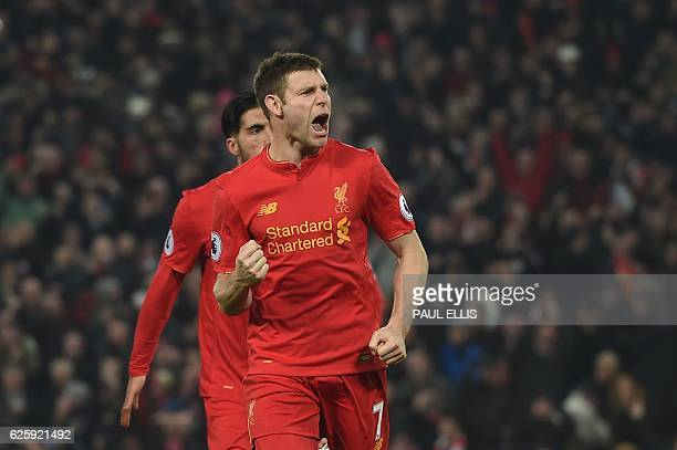 Liverpool's English midfielder James Milner celebrates scoring their second goal during the English Premier League football match between Liverpool...