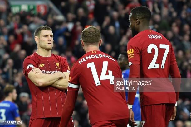 Liverpool's English midfielder James Milner celebrates with Liverpool's English midfielder Jordan Henderson and Liverpool's Belgium striker Divock...