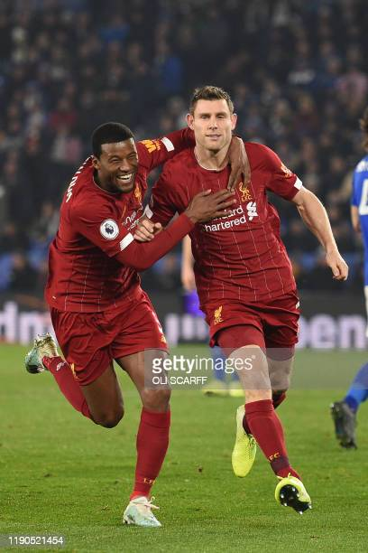Liverpool's English midfielder James Milner celebrates with Liverpool's Dutch midfielder Georginio Wijnaldum after scoring their second goal from the...