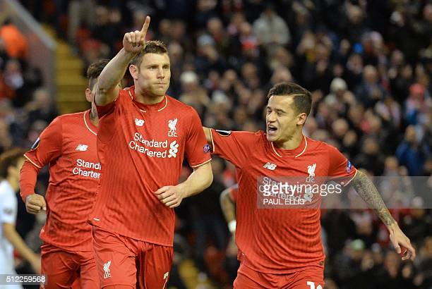 Liverpool's English midfielder James Milner celebrates with Liverpool's Brazilian midfielder Philippe Coutinho after scoring the opening goal from...