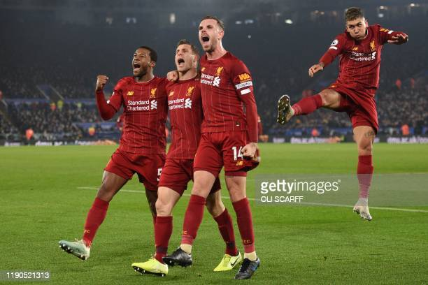Liverpool's English midfielder James Milner celebrates with teammates after scoring their second goal from the penalty spot during the English...