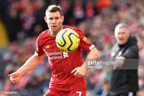 Liverpool's English midfielder James Milner controls the ball during the English Premier League football match between Liverpool and Watford at...