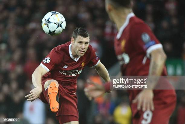 Liverpool's English midfielder James Milner controls the ball during the UEFA Champions League first leg semifinal football match between Liverpool...