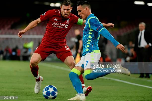 Liverpool's English midfielder James Milner defends against Napoli's Spanish forward Jose Callejon during the UEFA Champions League group C football...