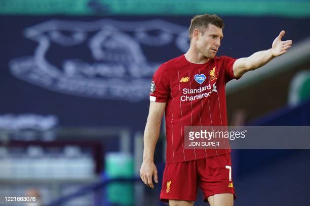 Liverpool's English midfielder James Milner gestures during the English Premier League football match between Everton and Liverpool at Goodison Park...
