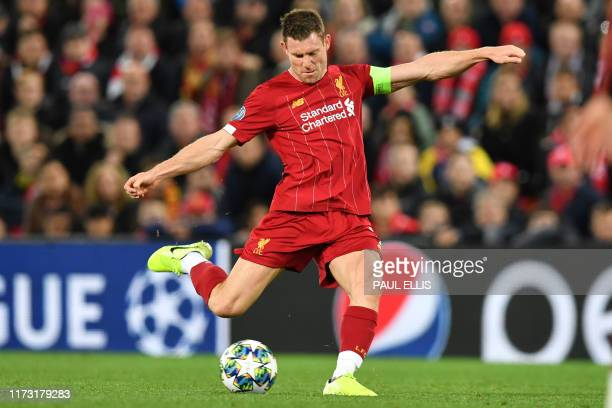 Liverpool's English midfielder James Milner has an unsuccessful shot during the UEFA Champions league Group E football match between Liverpool and...