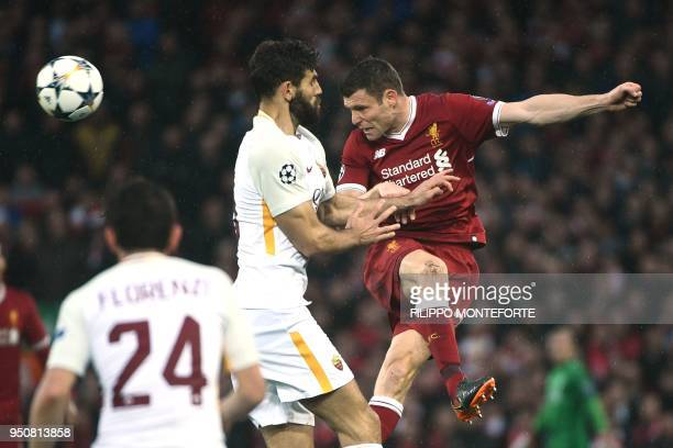 Liverpool's English midfielder James Milner heads the ball during the UEFA Champions League first leg semifinal football match between Liverpool and...