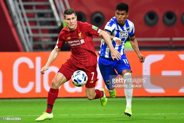 Liverpool's English midfielder James Milner is marked by Monterrey's defender Jesus Gallardo during the 2019 FIFA Club World Cup semifinal football...