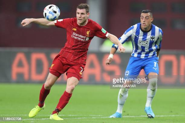 Liverpool's English midfielder James Milner is marked by Monterrey's forward Rogelio Funes Mori during the 2019 FIFA Club World Cup semifinal...