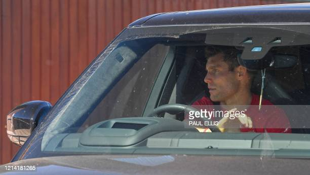Liverpool's English midfielder James Milner leaves Melwood in Liverpool north west England after training on May 20 as training resumes after the...