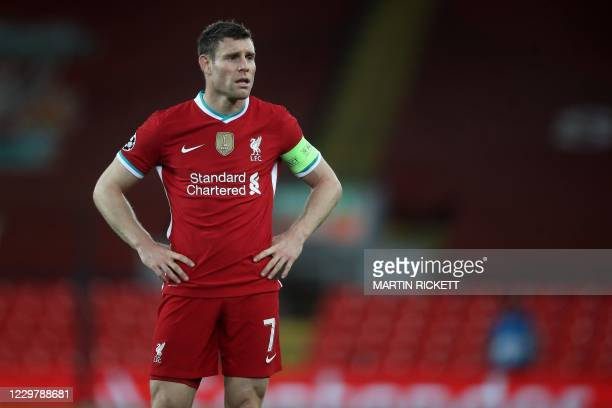 Liverpool's English midfielder James Milner looks on at the end of the game during the UEFA Champions League football match between Liverpool and...