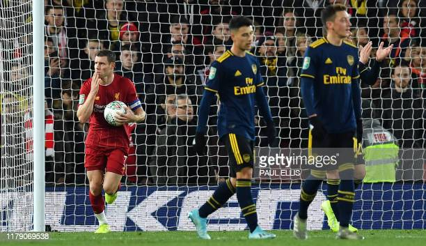 Liverpool's English midfielder James Milner passes Arsenal's Brazilian striker Gabriel Martinelli as he celebrates scoring his team's second goal...
