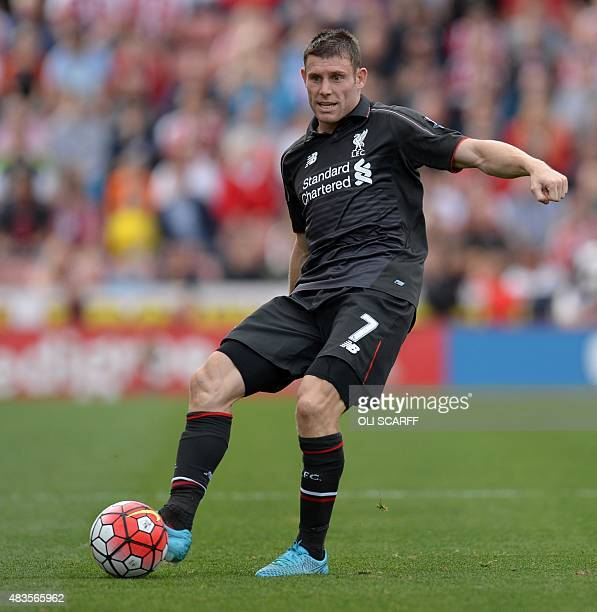 Liverpool's English midfielder James Milner passes the ball during the English Premier League football match between Stoke City and Liverpool at the...
