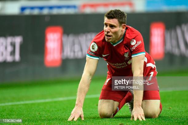 Liverpool's English midfielder James Milner reacts during the English Premier League football match between Newcastle United and Liverpool at St...