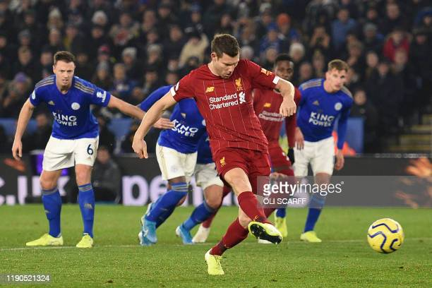 Liverpool's English midfielder James Milner scores their second goal from the penalty spot during the English Premier League football match between...