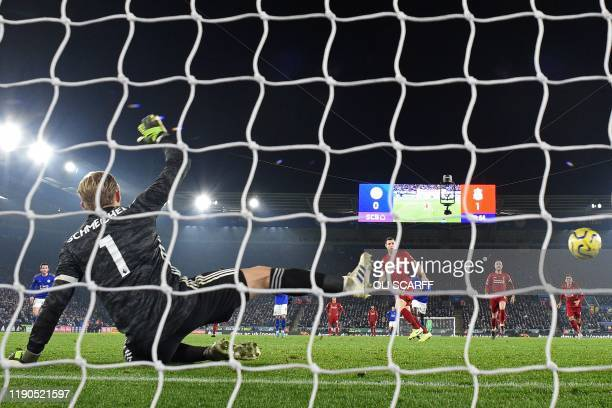 TOPSHOT Liverpool's English midfielder James Milner scores their second goal from the penalty spot during the English Premier League football match...