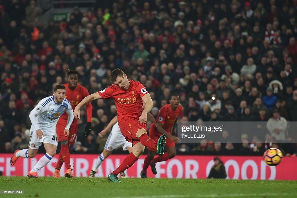 Liverpool's English midfielder James Milner scores their second goal from the penalty spot during the English Premier League football match between Liverpool and Sunderland at Anfield in Liverpool, north west England on November 26, 2016. / AFP / Paul ELLIS / RESTRICTED TO EDITORIAL USE. No use with unauthorized audio, video, data, fixture lists, club/league logos or 'live' services. Online in-match use limited to 75 images, no video emulation. No use in betting, games or single club/league/player publications. /