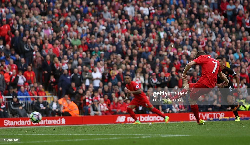 Liverpool's English midfielder James Milner shoots from the penalty spot to score his team's fifth goal during the English Premier League football match between Liverpool and Hull City at Anfield in Liverpool, north west England on September 24, 2016. / AFP / Geoff CADDICK / RESTRICTED TO EDITORIAL USE. No use with unauthorized audio, video, data, fixture lists, club/league logos or 'live' services. Online in-match use limited to 75 images, no video emulation. No use in betting, games or single club/league/player publications. /