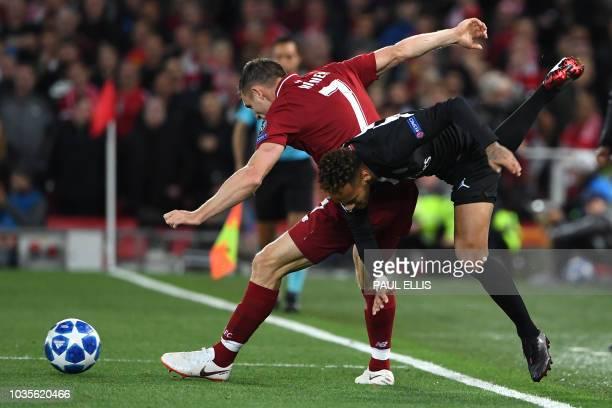 Liverpool's English midfielder James Milner tackles Paris Saint-Germain's Brazilian striker Neymar during the UEFA Champions League group C football...