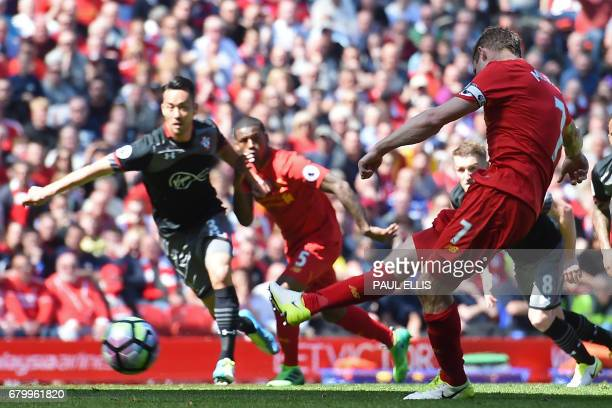 Liverpool's English midfielder James Milner takes a penalty during the English Premier League football match between Liverpool and Southampton at...