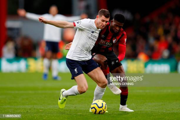 Liverpool's English midfielder James Milner takes on Bournemouth's Colombian midfielder Jefferson Lerma during the English Premier League football...