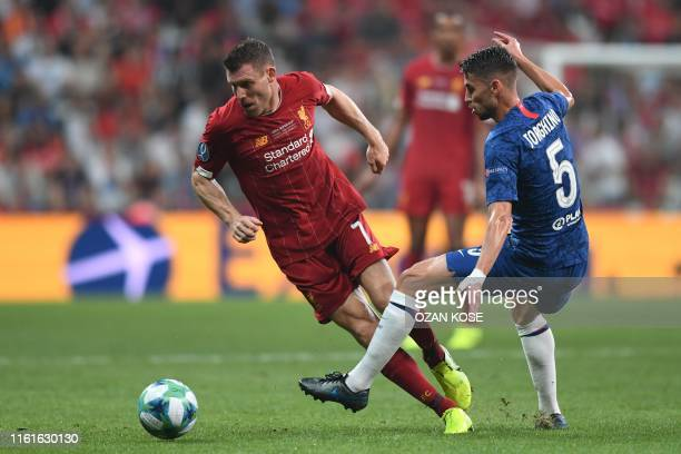 Liverpool's English midfielder James Milner vies for the ball with Chelsea's Italian midfielder Jorginho during the UEFA Super Cup 2019 football...