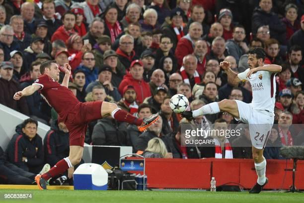 Liverpool's English midfielder James Milner vies with Roma's Italian midfielder Alessandro Florenzi during the UEFA Champions League first leg...