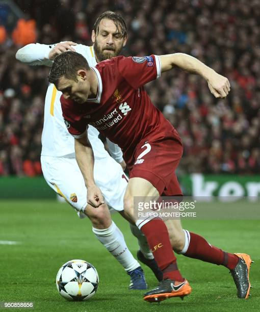 Liverpool's English midfielder James Milner vies with Roma's Italian midfielder Daniele De Rossi during the UEFA Champions League first leg semifinal...