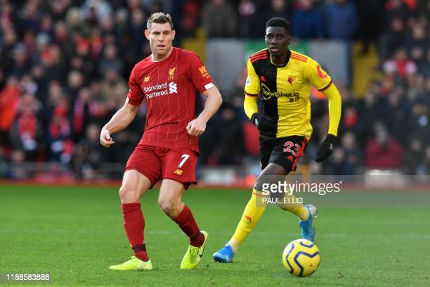 Liverpool's English midfielder James Milner vies with Watford's Senegalese midfielder Ismaila Sarr during the English Premier League football match...