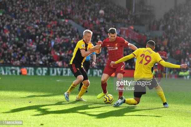 Liverpool's English midfielder James Milner vies wiuth Watford's French midfielder Etienne Capoue during the English Premier League football match...