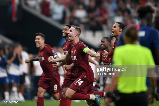 Liverpool's English midfielder Jordan Henderson and teammates celebrate winning the UEFA Super Cup 2019 football match between FC Liverpool and FC...
