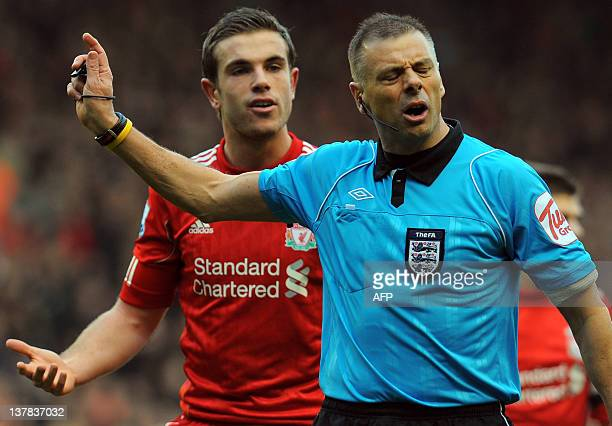 Liverpool's English midfielder Jordan Henderson appeals to referee Mark Halsey during the English FA Cup fourth round football match between...