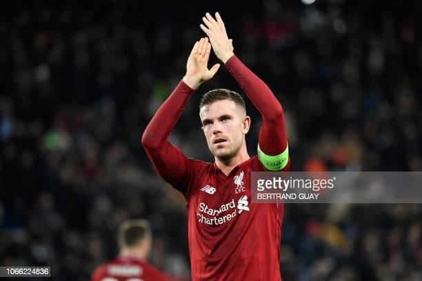 Liverpool's English midfielder Jordan Henderson applauds at the end of the UEFA Champions League Group C football match between Paris SaintGermain...