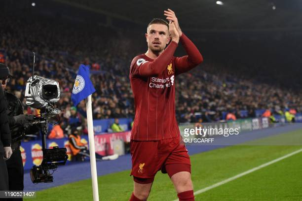 Liverpool's English midfielder Jordan Henderson applauds supporters as he leaves having been substituted during the English Premier League football...
