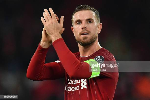 Liverpool's English midfielder Jordan Henderson applauds the fans following the UEFA Champions league Group E football match between Liverpool and...